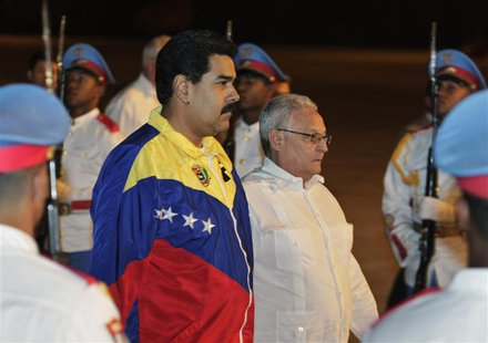 Venezuela's President Nicolas Maduro (centre L) walks with Cuba's Minister of Higher Education Rodolfo Alarcon Ortiz upon arrival at the Jos