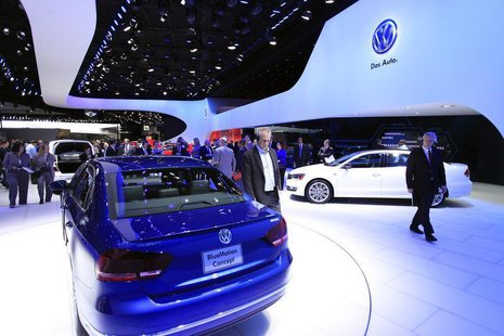 Visitors look at the Volkswagen Passat Blue Motion Concept during the North American International Auto Show in Detroit, Michigan January 15