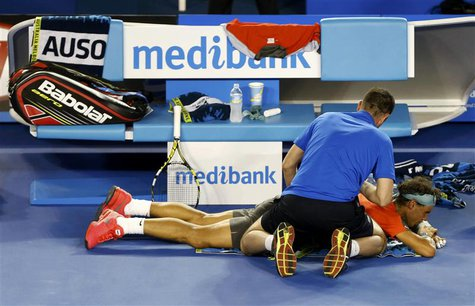 Rafael Nadal of Spain receives treatment during his men's singles final match against Stanislas Wawrinka of Switzerland at the Australian Op
