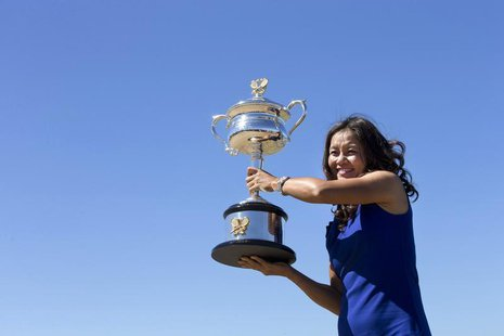 Li Na of China poses with the Daphne Akhurst Memorial Cup she won in the women's singles final match at the Australian Open 2014 tennis tour
