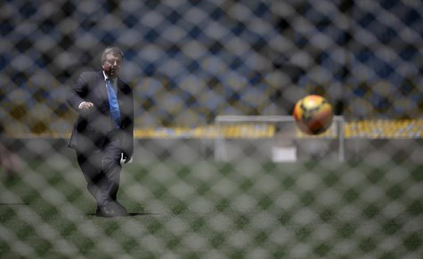 International Olympic Committee (IOC) President Thomas Bach kicks a soccer ball during a visit to Maracana stadium in Rio de Janeiro January