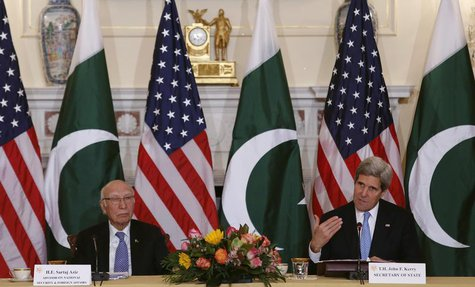 U.S. Secretary of State John Kerry (R) and Pakistan's National Security and Foreign Affairs Advisor Sartaj Aziz deliver opening remarks at a