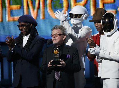"Producer Paul Williams accepts the award for Album of the year for Daft Punk's ""Random Access Memories"" as Nile Rodgers (L) and Pharrell Wil"