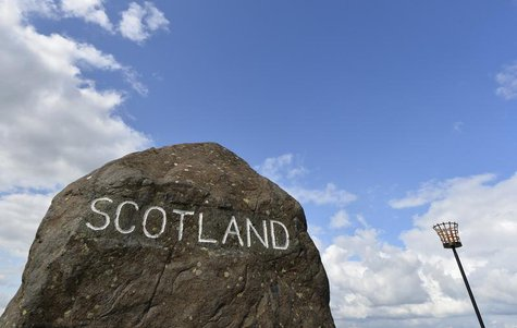 A marker stone is seen at Carter Bar in the Scottish Borders August 22, 2013. REUTERS/Toby Melville