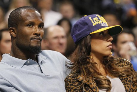 Denver Broncos cornerback Champ Bailey watches the Denver Nuggets play the Los Angeles Lakers with an unidentified woman in Game 4 of their