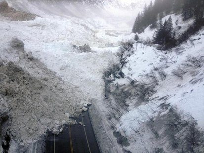 Avalanche debris is pictured on the Richardson Highway in Alaska in this January 25, 2014 handout photo. REUTERS/Alaska Department of Transp