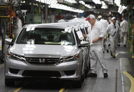 Clif Small is seen getting a 2013 Accord ready to come off the line during a tour of the Honda automobile plant in Marysville, Ohio October