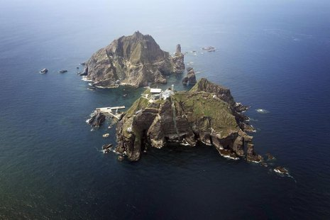 A set of remote islands called Dokdo in Korean and Takeshima in Japanese is seen in this picture taken from a helicopter carrying South Kore