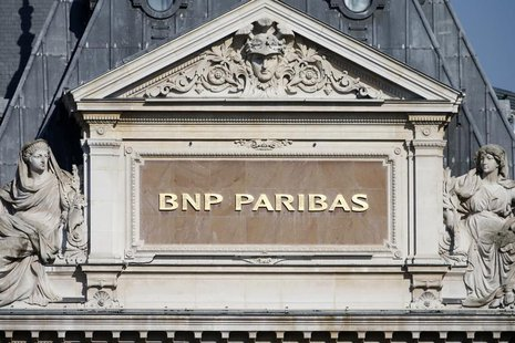 The BNP Paribas plaque is seen on the roof of one of their main banks in central Paris February 18, 2013. REUTERS/Charles Platiau