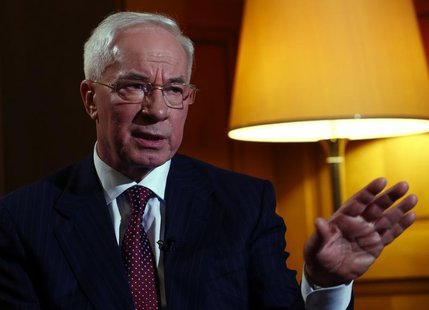Ukrainian Prime Minister Mykola Azarov gestures during an interview with Reuters at the annual meeting of the World Economic Forum (WEF) in