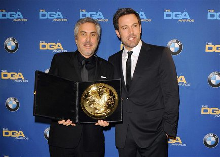"Actor and director Ben Affleck (R) presents Mexican director Alfonso Cuaron with the Feature Film award for ""Gravity"" during the 66th annual"