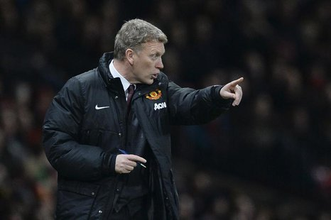 Manchester United's manager David Moyes gestures during their English League Cup semi-final second leg soccer match against Sunderland at Ol