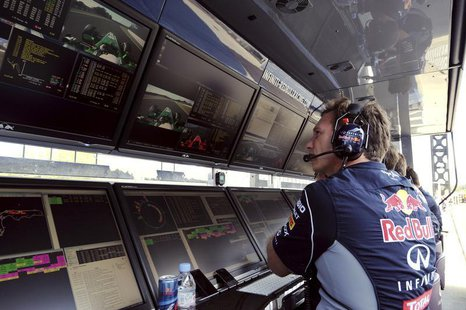 Red Bull Team Principal Christian Horner watches the monitors during the qualifying session ahead of the Formula One Japanese Grand Prix in