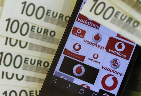 A photo illustration shows the company logo of mobile phone provider Vodafone and some 100 Euro bank notes in Vienna January 16, 2014. REUTE