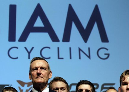 IAM cycling team founder and main sponsor Michel Thetaz looks on during the team presentation in Geneva January 14, 2013. REUTERS/Denis Bali