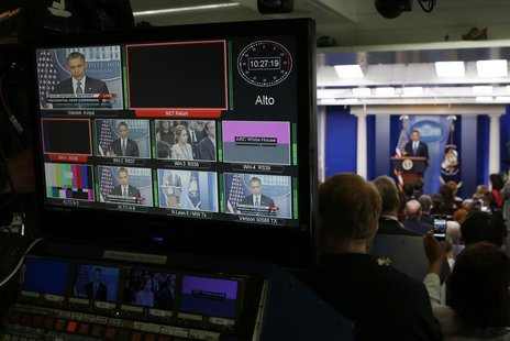 U.S. President Barack Obama is seen on a network video distribution console while he talks about the economy in the White House Press Briefi