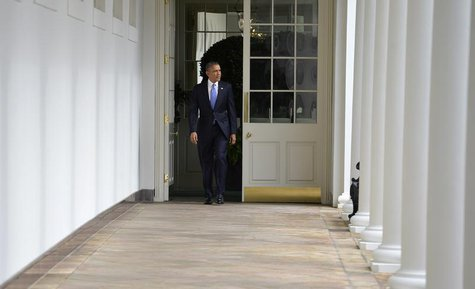 U.S. President Barack Obama walks the colonnade from the residence of the White House to the Oval Office in the West Wing, to continue work