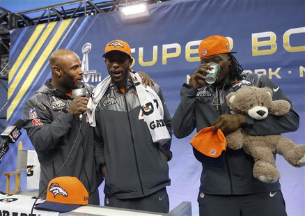 Denver Broncos free safety Mike Adams (L) interviews teammates Dominique Rodgers-Cromartie (C) and Danny Trevathan during Media Day for Supe