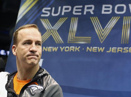 Denver Broncos quarterback Peyton Manning pauses during Media Day for Super Bowl XLVIII at the Prudential Center in Newark, New Jersey Janua