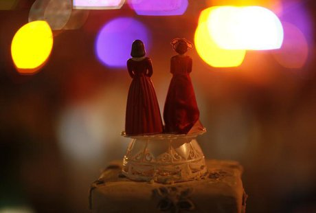 Two bride figurines are seen during a rally in response to the California Supreme Court's ruling regarding Proposition 8 in Hollywood, Calif