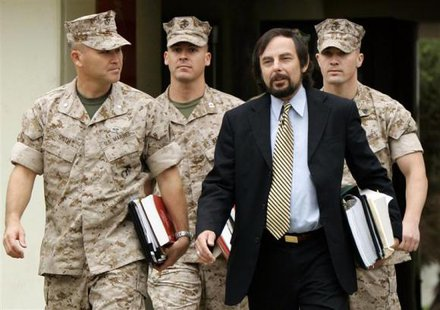 U.S. Marine Sgt. Lawrence G. Hutchins III (back R) arrives with his civilian defence counsel J. Richardson Brannon (front R) and military defence counsel Lt Col Joseph S. Smith (front L) and Captain Alan Bass for his Article 32 Investigation hearing at Camp Pendleton, California, in this October 16, 2006 file photo. CREDIT: REUTERS/MIKE BLAKE/FILES
