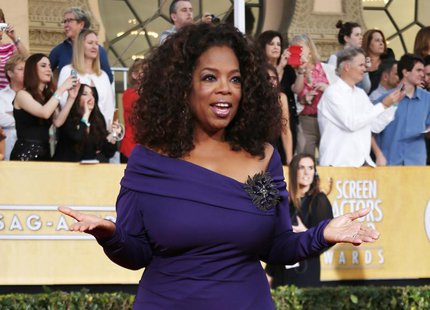"Actress Oprah Winfrey from the film ""The Butler"" arrives at the 20th annual Screen Actors Guild Awards in Los Angeles, California January 18"