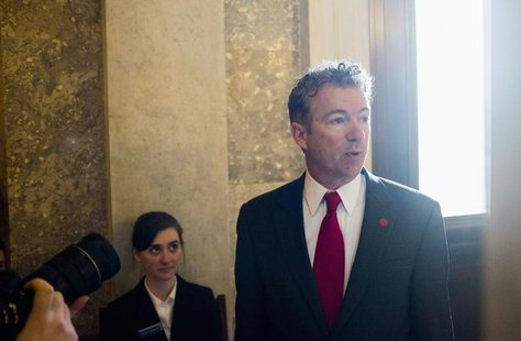 Senator Rand Paul (R-KY) arrives for the Republican weekly policy luncheon on Capitol Hill in Washington January 28, 2014. REUTERS/Joshua Ro