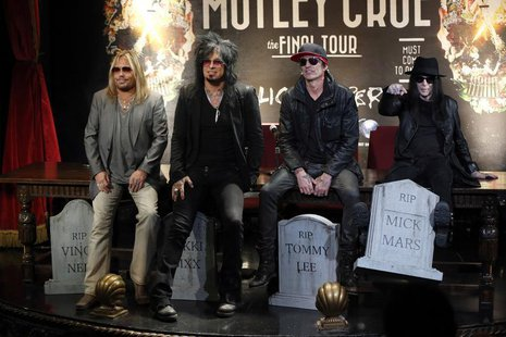 Members of rock band Motley Crue (L-R) Vince Neil, Nikki Sixx, Tommy Lee and Mick Mars pose at a news conference announcing The Final Tour i