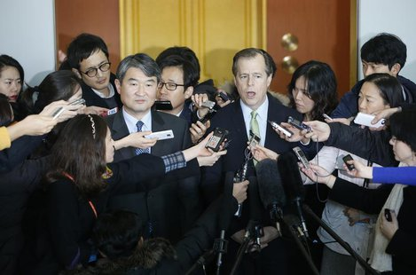 U.S. Special Representative for North Korea Policy Glyn Davies (R from center) answers questions at a news conference after a meeting with C