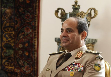 Egypt's Army Chief General Abdel Fattah al-Sisi attends a meeting with Egypt's interim President Adly Mansour, Russia's Defence Minister Ser