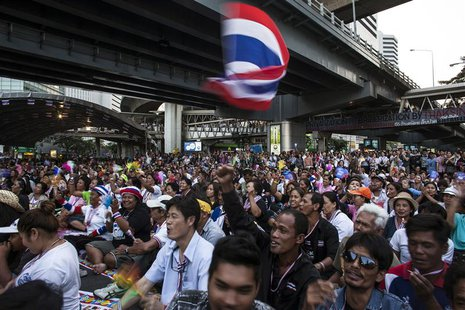 Anti-government protesters react as protest leader Suthep Thaugsuban (not pictured) speaks during a rally in central Bangkok, January 28, 20