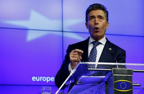 NATO Secretary General Anders Fogh Rasmussen holds a news conference while taking part in a European Union leaders summit at the EU council