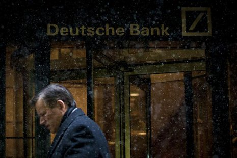 A man walks past the Deutsche Bank offices during a snow storm in Manhattan's financial district in New York January 21, 2014. REUTERS/Brend