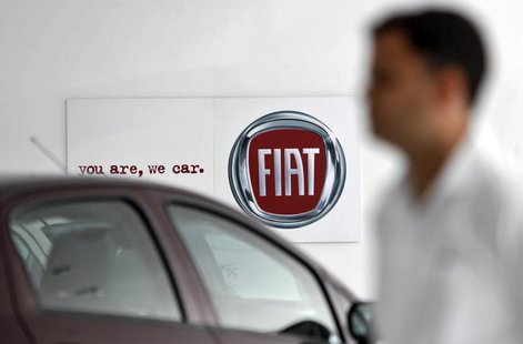 A man walks past a Fiat logo at a showroom in Noida, on the outskirts of New Delhi April 3, 2013. Indian tax officials have opened up a new