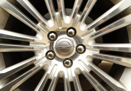 A Chrysler logo is seen on the wheel of a new car at a dealership in Vienna, Virginia April 26, 2012. .REUTERS/Kevin Lamarque