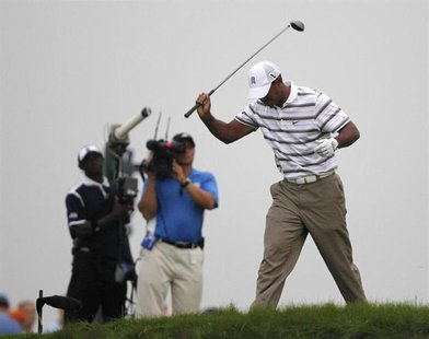 Tiger Woods of the U.S. reacts after his tee shot on the sixth hole during the second round of the 92nd PGA Golf Championship at Whistling S