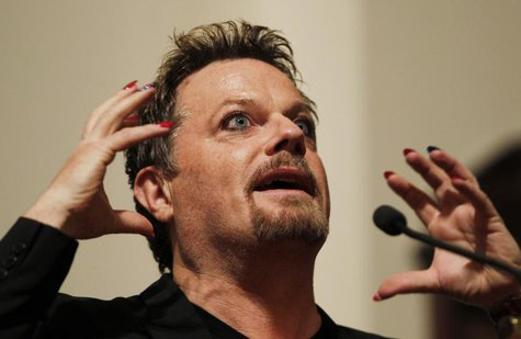 Comedian Eddie Izzard gestures as he speaks after being presented with the 6th Annual Outstanding Lifetime Achievement Award in Cultural Hum
