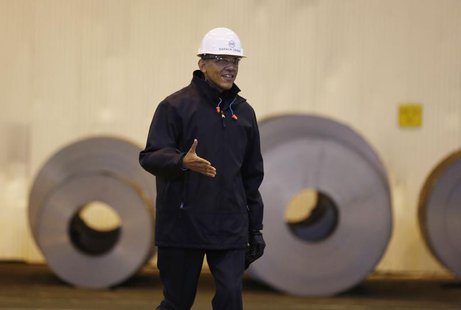 U.S. President Barack Obama extends his arm for a handshake as he tours the U.S. Steel Irvin Plant in West Mifflin, Pennsylvania, January 29
