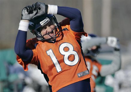 Denver Broncos quarterback Peyton Manning (18) does a stretching exercise during their practice session for the Super Bowl at the New York J