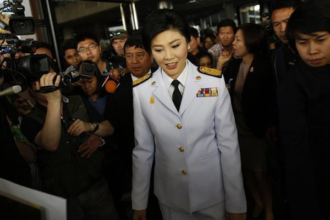 Thailand's Prime Minister Yingluck Shinawatra leaves the Army Club after meeting the Election Commission in Bangkok January 28, 2014. REUTER