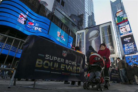 A woman walks through Times Square which has been transformed into Super Bowl Boulevard ahead of Super Bowl XLVIII in New York January 29, 2