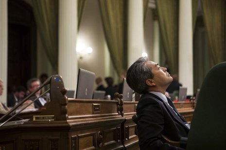 California Assemblymember Al Muratsuchi (D-Los Angeles) listens to arguments in favor and opposition to AB10, a bill that raises the Califor