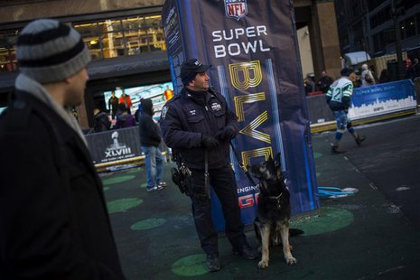 A police officer stands watch as preparations continue for Super Bowl XLVIII in New York January 29, 2014. REUTERS/Eric Thayer