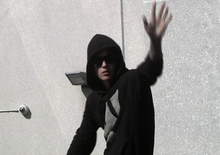Pop singer Justin Bieber waves to fans as he leaves a jail after being released on bail in Miami, Florida in this still image taken from vid