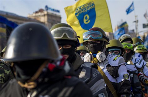 Members of various anti-government paramilitary groups gather at Independence Square during a show of force in Kiev, January 29, 2014. REUTE