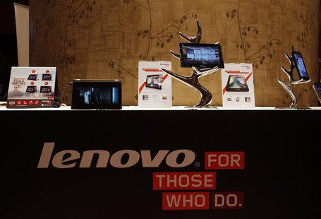 Lenovo tablets and mobile phones are displayed during a news conference on the company's annual results in Hong Kong in this May 23, 2013 fi