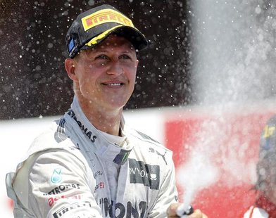 Mercedes Formula One driver Michael Schumacher of Germany sprays champagne during the podium ceremony after the European F1 Grand Prix at th