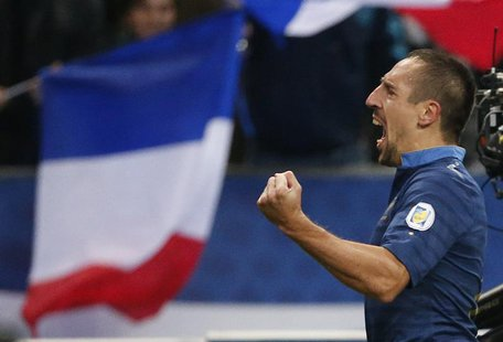 France's Franck Ribery celebrates after scoring against Finland during the 2014 World Cup qualiying soccer match at the Stade de France stad