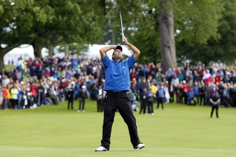 Italy's Edoardo Molinari reacts to his first putt on the eighteenth green before winning the Scottish Open golf tournament at Loch Lomond go