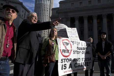 People hold signs protesting against the Stop-and-Frisk program, at a news conference outside the Federal Court in New York November 1, 2013